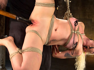 Lorelei Lee Submits in Brutal Bondage with Grueling Torment!!! : Lorelei is back and holy shit does she look fucking amazing. Her flowing blonde hair, her natural body with a great ass and amazing tits inspire me to do things to her very bad things. We begin with her standing with her legs spread. I want to be close to her so I can hear her scream. I want to feel her push that glorious ass back when my hand wraps around her throat. Next she is in a very compact predicament tie on a box. Her body contorted just enough to cause a little added stress to her muscles, yet display all of the good parts at once. Her feet are destroyed with a full assault from bands to canes and I dont stop until I have to. Next she is put in a side suspension with one of her legs pulled high to ensure I get full access to her pussy, or as I like to call it, the honey hole. Her milky white skin is quickly turned a bright red from the cat of nine assaulting her flesh. Her pussy is then stuffed full with a big dildo and she is fucked and made to cum with little concern for her liking it or not.For the finale Lorelei is on her back and spread as wide as I can get her. Her nipples get brutalized with clamps and added weights. A butt plug is shoved in her tight ass and then her pussy fucked again. Every orgasm she has makes her toes curl which pulls on her nipples and yet she begs to have another orgasm.