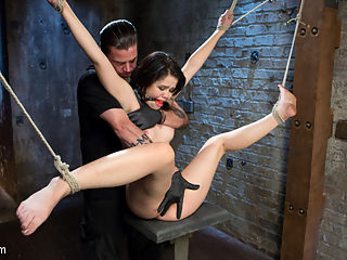 Sweet Yhivi is Decimated in Brutal Bondage, Torment, and Screaming Orgasms! : Yhivi did her first porn shoot ever with me a couple of years back. She is hotter than ever and man has she blossomed. i start with her standing so that we can remove the clothes to expose her hot body. I take one of her legs and pull it up to make her pussy helpless to what I wanted to do. Next she is tied upside down in a chair and the foot torment begins. She is put through excruciating pain then I start to fuck her tight little pussy until she begs for me to stop making her cum. I take the dildo and us it to shove down her throat while fucking her face.Its time to make this slut fly, so she is put in a brutal two point suspension. She is flogged and then made to cum until she cant take it anymore.In the final scene she is as helpless as it gets with her limbs all pulled in different directions. She sits on a small platform knowing that its going to be all or nothing now. I slap her around a little bit and then make her cum more than she has all day combined. She squirms and begs, but Im not stopping. She pleads and then starts to bargain and I still dont stop until I think shes had enough.