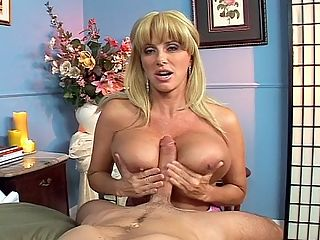 Super Boob MILF Sex : Sometimes an editor wishes that a particular model had been filmed numerous times while she was active instead of only three or four times. Thats the situation with Penny Porsche, an older busty blonde with great sex appeal and a very sexually uninhibited personality. Penny was a hot talker. She starts off this P.O.V. scene talking, showing her great big tits and jacking, sucking and tit-banging a dick she lubed with her mouth. She sits on his cock and bounces away. It would be great if she came back.br br Penny talked about sex and how much time it usually takes.br br Twenty minutes is the standard. Im talking about the full session of intercourse and sucking dick and eating pussy. But thereve been times when Ive gone for hours. The only thing is that when I go for a really long time, it tends to swell my pussy. All that rubbing makes me raw, and then I dont want to have sex the next day, and God forbid if you dont want to have sex the next day. So I think a good amount of time is 20 minutes to a half-hour. Because I can cum over and over. If the guy knows what hes doing, you wouldnt believe how many times I can cum. I can cum in 15 or 30 seconds. I think its very important to suck a guys cock the right way. Some guys like to have their cocks stroked a certain way, and other guys like to have their balls licked, and some guys like to have their butthole fingered. That makes them cum more while youre sucking their dick, but other guys are afraid to have a finger up their butt. Everybodys different.