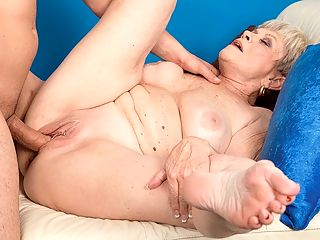 Afternoon Delight : Lin Boyde, a 65-year-old divorcee from Arizona, returns to discipline a younger guy with her mouth and pussy and winds up with a big load of cum all over her face. Lin is a well-sexed woman, and like most well-sexed women her age, she knows exactly what shes doing, exactly how to handle a man whos nearly 40 years her junior. Ironically, in this scene, Lin is a boss who disciplines her employee, but in real life, Lin says she prefers take-charge men who make romantic gestures.br A cum facial...is that romantic?br Sex doesnt always have to be romantic, Lin said. Im a swinger, and my guy and I had sex in front of a crowd of people in a club. That wasnt romantic. That was hot!br Theres something very horny and sexy and hungry about Lin, as if she can never get enough. She doesnt merely suck and fuck cock. She devours it. With the right man, I could have sex several times a day, she said. And for Lin, the right man is easy to find. He has a hard-on.