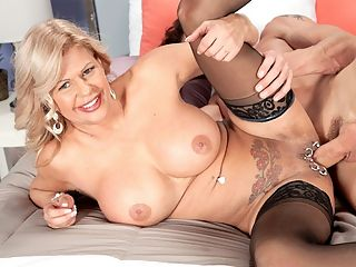 Busty bosses with pierced pussies love hard cocks : Thanks for picking me up and bringing me home, 54-year-old Deb says to Tony at the start of this scene. Would you like to come in for a while?br br She pushes him down onto the bed. You see, hes already in.br br Is this your bedroom? he asks stupidly.br How do you like it? she asks.br I love it, he says. Whats this guy, an interior decorator? Is this an episode of Love It Or List It? Or is it Love It and Fuck It!br br Youre gonna love what were gonna do with it. Or in it, she says.br He continues to play stupid. He doesnt know what shes talking about. Or maybe hes playing stupid.br Ive had my eye on you for a long time, she says.br He cant believe it, although what did he expect when this busty MILF accepted his offer of a ride? Did he think she thought he was being a Good Samaritan?br br Ah, we get it! Shes his boss! And hes been flirting with the young girls in the office, perhaps not even thinking about fucking the boss...not knowing about her big, fake, DDD-cup tits and all those piercings on her pussy...not knowing shes horny for cock all the time.