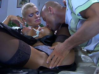Viola and Marcus hardcore mature video : Looking all dolled-up and sexy mature Viola provokingly opens up her stockinged legs to tempt a young stud into a quickie on the sofa. Marcus really falls for it, and soon he has his mouth on those big mature globes before lapping up that dripping snatch. Surely the horny older bombshell returns the favor sucking off her lover and straddling him in the reverse cowgirl before trying other fuck positions as well.