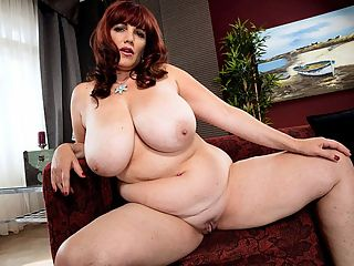 Roxees Robust Rack : My titties feel so good, says Roxee Robinson as she rubs Canadas national treasures. No doubt they do. Yes, we have our great ally Canada to thank for Roxee. The redhaired mynx spoke to us from her home.br br XLGirls Roxee, who, or what, motivated you to become an adult model?br br bRoxee My boyfriend. He took some sexy pictures of me about five years ago. I had no idea I was that sexy! I started posting my sexy pics online. I got amazing feedback. It got me hooked. Ive been taking sexy pics of myself every chance I get ever since. I wanted to show off my sexiness, so I started looking into places to show off.bbr br XLGirls How long have you been modeling?br br bRoxee I just started this year.bbr br XLGirls How did we find you?br br bRoxee Elliot James first discovered me on a breast forum in 2012 and suggested I apply to SCORE. I did apply, but I wasnt accepted at the time. Then, in April 2015, a SCORE Group model recruiter contacted me through Twitter. This time I was accepted. It took a while to get my shoot booked, but it was well worth the wait because SCORE sent me to Prague for my shoot!bbr br XLGirls How did you like shooting in Prague?br br bRoxee I had a wonderful time in Prague. The crew that I was with was amazing. They were so professional as well as warm and welcoming. Prague was incredible. That was my first trip to Europe.bbr br XLGirls Did you have time to play tourist?br br bRoxee I did get to enjoy a little bit of Prague. My photographer took me on a drive to tour Prague and showed me all the incredible sights that tourists go to Prague to see. I also took a few walks to really take in the architecture. The buildings there are breathtaking. I also visited the mall for shopping. After wrapping up my final shoot on Saturday, the weather was so great that I went on a two-hour walk. I walked by the river where there was a music festival going on. I wish I had a little more time there. I would have gone to tour Prague Castle.b