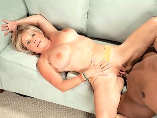 Lexis Black Cock Attack : In her first interracial scene, 64-year-old Lexi McCain gets the Lucas treatment, although perhaps we should say that Lucas gets the Lexi treatment. She takes over this scene from the start, devouring Lucass cock, slobbering all over it, then riding it hard. Lexi is a bit of a wild woman shes a swinger, and she hangs out with Rita Daniels, and in this scene, shes hornier than weve ever see her. I really wanted that big, black cock, Lexi told us afterward. He was walking around swinging it near my face all day, and I had to have it. By the time the cameras started rolling, Id already fingered myself in the ladies room three times.br Fortunately for us and Lucas, Lexis private sessions hadnt frigged the cum out of her. Here, she seems to be enjoying herself very much, and her body looks great in that tight, sexy outfit. And can you believe shes 64? We cant. Lexi, youre getting better every time we see you.
