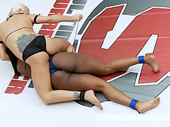 Blond Bombshell, Holly Heart punished curvaceous Rookie, Layton Benton : Holly Heart is back for season 13 and in the spirit of classic US season premieres, we put her against a rookie so she can squash her. The rookie is trapped on the mats and makes pathetic noises while she is finger fucked tirelessly. Holly shows no mercy and even makes the rookie quit before she can go 3 rounds. Loser is brutally humiliated and worships the winners body and feet