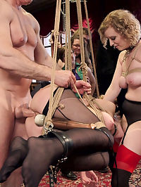 Young Anal Slut Trained in Cock Worship : Alina is a pretty little package with a round ass, long legs, and a deep hunger for cock. However, her discipline is lacking and it will take the iron hand of Cherry Torn to right her course in anal cock worship. Cherry comes right out of the gate with electrical toys and cattle prods to teach the trainee rules in front of a jeering crowd. In her estimation Alina did not earn any dick with her performance, and Cherry steals it away in her tight pussy while making Alina lick the crowds shoes and take a punishment orgasm on her clamped pussy. The rest of the day is spent using Alinas face as a cum rag while Cherry Torn enjoys hard cock in her slutty ass in front of a laughing crowd. The guests get horny and spend the day taking floggings, riding the sybian, suspending each other, and fucking like bunnies. When Alina finally earns herself a fucking, it is in a difficult suspension while reciting her rules. She cums and cums, but only while under duress. Well done Cherry Torn! She makes a fine slave.