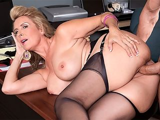Hot wife Laura Layne eats cum : Laura Layne, a 50-year-old wife and mother from Scottsdale, Arizona, makes her debut in as hot a first-time scene as weve ever seen. Its not just Lauras sex skills, which are impressive check out how she goes down on her guys cock while hes on the phone. Its her overall look sexy face, big tits, curvy body, shaved and tattooed pussy and attitude and the way she projects her sexuality. This is clearly a woman who loves to fuck.br br Im a swinger, Laura said. I started swinging right after I got a divorce and wanted to experience life. I met my current husband, and Im still swinging!br br Laura is 57 and measures 34DD-28-36. She enjoys decorating her house, cooking and spoiling my three Italian greyhounds. She lives in the desert, where she says wearing less is better. She describes her perfect day as lounging around my pool and not having a schedule. Just being spontaneous and getting on the bike for a ride with my hubby. Then a nice dinner and a quiet, sexy evening with my man, finished off with some skinny dipping and passionate sex. That makes for a happy girl!br br Laura has been a secretary and a web designer. She once had sex on a lifeguard stand on a beach in San Diego.br br I got fingered and squirted for the first time. My legs were shaking so bad, I couldnt get down.br br Shes enjoying herself here, sucking and fucking, getting her pussy eaten, opening her mouth for cum, playing with it in her mouth. Youll enjoy her, too.