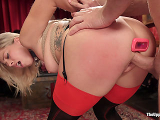Bombshell Blond Anal Queen Trains New Slave Girl : Zoe Monroe is truly sexually voracious and shows up to serve with a wet pussy ready to ride cock for the crowds amusement. Under her wing is doe eyed newbie Samantha Hayes, a slutty masochist that cant get enough pain and begs for orgasms like a brazen whore. Zoe does everything like a good girl, fetching drinks, answering questions, and amusing guests with one hand while shocking and spanking Samantha using the other. Both slaves are truly gifted in sexual service, and provide much pleasure for our guest of honor and his hard dick while tied tight in bondage and tormented by Stefanos and the guests. Meanwhile the party is packed with hot couples fucking, riding the sybian, and paddling each others asses. Its truly a vibrant and filthy night on The Upper Floor!