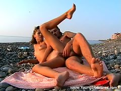 Seashore sunbathing and fucking : This tattooed guy sure knows how to knock a cute chick off her feet. He takes this teeny he met in town to a lovely beach and she can and apost resist the temptation to make love by the sea. Watch her suck and ride his cock right on the pebbles and take a mouthful of cum in this great video.