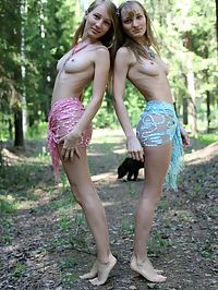 Lesbians with nice bodies : Teen girls with lovely curves posing before camera smiling seductively at us