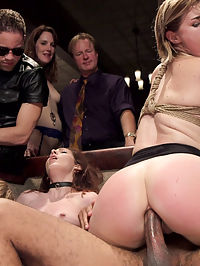Anal Slut Slaves Serve a BDSM Swingers Orgy : 4 Sexually Submissive Slaves serve 1 Cruel Mistress, 190 BDSM Swingers and many hard cocks in this explosive update celebrating the BDSM lifestyle and sexual liberation. Ember and Ella have their work cut out for them representing the virtues of Bondage and Discipline. Ember is firmly tied down in rope bondage and fucked into a state of hysterical screaming orgasms while Ella attempts to keep her orgasms in and hold her service tray straight while eating her Mistress pussy. It isnt long before Ella loses her tray and has her face used to clean up the sex of her slave sister. Both slaves are offered up for spankings from the crowd as punishment. The crowd is wonderfully horny at this point and find themselves fucking all over the room in tight rope bondage, using whips, electrical toys, and floggers. Once the slaves bottoms are properly pink, Ella had a huge cock shoved in her ass and is made to perform for the crowds amusement while Ember takes a ride on the furious hand of Aiden Star. When the other 2 slaves Joseline and Savannah enter the lounge the sex goes off like fireworks and transforms the party into a screaming avalanche of orgasms and wild sex. Parties like this one only happen once in a great while, dont miss it.