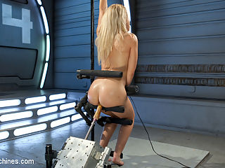 Golden-Haired, Teen Gets Schooled By Fast, Fucking-Machines : The innocent, young, blond-haired, school-girl Goldie Rush takes a wild ride on our fastest fucking machines. First she gets rammed into a sweating, squirting mess in a standing position that sticks her perfect ass out on display for the whole world to drool over. Then she shows off her perfect cheerleader form by flipping into a pile-driver position and then takes an athletic fucking unlike anything you have ever seen before. A true fucking machines first!! And just when she thought it was over she takes a wild ride on our most powerful sybian. By the end, she is glistening with sweat and her pussy is trembling, cum-drunk, and soaking wet. Dont miss this little sex-kittens epic shoot!