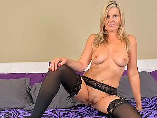 Horny blonde mommy Velvet Skye strips out of her lingerie and caresses her nice body. Once she is all worked up she begins massaging and finger fucking her pink wet pussy until she reaches orgasmic pleasure.