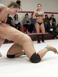 December tag Team Erotic Wrestling Match up : Today we have Jayogen and Angel Allwood for TEAM BEAST Taking on Mia Li and Karma Karma for TEAM MUSCLES. This is Karmens very first tag match up and she is sure to be back for more. Karmen and Mia are able to tag up on Angel Allwood and finger fuck her right in front of Angels husband who is sitting in the live audience. Every female wrestler wants to kick ass for her man but Angel has to endure brutal face sitting and fingering all while her beloved husband sits and watches