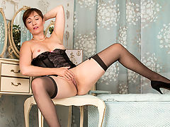 Mature mommy Kitty Creamer shows off her sexy curves as she strips down to her black lingerie. Once this horny cougar gets all worked up she slides her fingers inside her juicy snatch until she reaches climax.
