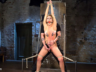 Hot Blonde MILF Suffers Through Grueling Bondage : We go into this shoot differently than our usual shoot. This will be with minimal breaks, and if possible none at all. We begin with Cherie standing with her hands above her head, torment the hell out of her, make her cum, then move straight into the next scene. A chair is brought in and she is quickly sat down and the bondage transforms to adapt. She is helpless to the sadistic hell that she is put through and begs for it to stop. Next she is is a side suspension where she is fucked in her pussy and mouth after enduring extreme corporal punishment. All of the tying is shown as she goes into the bondage. In the final scene she is in a grueling back bend. Again she is terrorized by The Pope until she has been used up, then made to cum one final time.