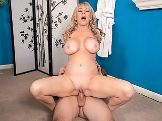 A Busty MILF Goes For A Rub-down : Blonde MILF bunny Tarise Taylor wants a rub-down. As a bonus, this masseur JMac kicks in a free screwing several days a week depending on how the client looks. It was Tarises lucky day.br br Tarise was 47 when she visited The SCORE Group. She looks younger than her age and her body is nice and tight. Why cant all women her age look like this former Raiderette, a cheerleader during the time the Raiders were based in Los Angeles. br br Said Tarise Because theyre married and they have big vans and they dont have to work and they sit around a lot. And I have energy. Im a young soul. I love everything. I love sports. I love the beach. I never watch TV, but Ive been into Netflix lately.br br Tarise is doing it right, thats for sure.br