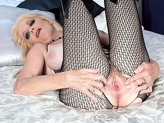 The naughty nurse : Im the girl next door, but theres something a little secretive there, too, said Charlie Charm, a 63-year-old wife, mother and grandmother from Colorado whos back for some solo action in this bonus posting. Im a nurse who has a naughty side. Im a naughty nurse.br br Here, naughty Charlie is wearing a fishnet bodystocking.br br I really would love to be taken, she says. Id love to be tied up. Id love for you to tie me up with ropes. Put my hands behind my back. Tell me what to do.br br But no one is around, so Charlie rips open her fishnets and vigorously fingers her pussy. Its a damned good show.br br We asked Charlie what gets her off, and she said, Masturbating til I get off then having a hard cock making me cum again.br br Thats what happened shortly after this scene, and youll get to see more of Charlie in hardcore action very soon.br br br