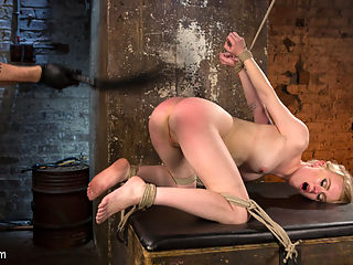 Blonde Pain Slut in Brutal Bondage and Suffering Grueling Punishment : Super sexy Anna made a special request to shoot for us. She is a self proclaimed rope and pain slut, so we agreed. The first position is a standing spread eagle that is later transformed into a predicament position. Her little smirk turns to a grimace as the torment gets more brutal. The next position spreads her out and leaves her helpless. Bastinado is issued to her sensitive soles and the room is filled with her screams of agony. Her body is covered in clothespins, her pussy fucked and the pins beaten off of her.Next Anna is pulled into the air in a crouching ball tie. Her body is abused more and then orgasms are ripped from her pussy until she begs for it to stop. In the final scene we have this slut with her as i the air and her arms strappado to keep her face pressed down. The punishment comes in the form of a severe ass beating and then made to cum one final time.