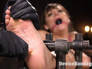 Big Tit Brat Gets Diabolic Discipline : Charlotte is a fan girl who decided instead of watching bondage and masturbating all the time that she would join the industry and be part of it. This is her third shoot with me and its time to put the brat in a fucking cage. I set the pace of the day by putting this slut on a pussy perch and spread her out wide. All of her weight rests on her slutty little cunt and its evident that she is suffering immediately. Next she is in a floating seated position with her pussy fully exposed. Her feet are also on display and I ensure that this brat suffers with a brutal caning to her delicate soles. Her pussy and mouth get fucked and then her pussy squirts from over stimulation.In the final scene our brat has her arms and legs belted and the wrapped, but she is free to roll around, rather get thrown around and man handled. I use her like the slutty little piece of meat she is and when Im finished with her I leave her writhing in the middle of the floor.