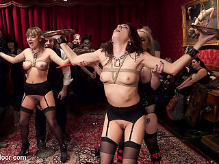 Hot Slave Girls Degraded, Fisted and Fucked : Two pieces of fine slave flesh are up for consideration. On hand we have busty blond powerhouse dominatrix Aiden Star to run these sluts through the ringer and decide who should join the sex slave stock for good. The swinger party is packed with gorgeous women playing with their dominants and submissives. Meanwhile good girl Charlotte Cross and nymphomaniac Nikki Knightly are tied tightly to a post and made to choke on cock and lick ass while interrogated. Once Aiden has the answers she is looking for both slaves are made to cum for the crowds amusement. Second trial of the evening finds the ladies tied with their legs back and hands latched down to a box in tight rope bondage. Unable to get away, they are punished and fucked in turn with hard cocks, vibrators, electrical shockers, and a pile of canes. Both ladies beg for punishment and pleasure until the whole scene devolves into a fuck pile with Aiden cumming on top. So far both slave wannabes are neck in neck, so The Upper Floor classic is deployed The Tray Test. Both slaves are handed their object of desire, a slave collar, and told to the hold the trays until one of them must drop it from physical exhaustion. To make the game more fun vibrators are attached to both their dripping wet pussies, and they are made to cum uncontrollably for the laughing audience. Both ladies quiver in agony, pushing their athletic abilities and self control until one drops. Once the new slave girl had won her collar she is rewarded with a rough fucking with a hard cock while the loser gets strap on plowed and has Aiden sit on her loser face. The night ends with fisting, squirting, and lot of hot cum swapped. Well done ladies.