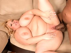 Diesel Fucked Me! : In this newly remastered video scene, we unleash Shane Diesel on Cassie Blanca. Cassies never been fucked by a dick like the one Diesels got, 10 inches by 8 inches in circumference. Most women can barely get their mouths around it and suck more than a few inches. Its just too big. br br Over at iSCORELANDi, German anal-porn superstar Annina once tangled with Diesel and she couldnt get it down her throat either, and forget about her ass. After some tit-chat with XL Girls master of ceremonies, whos refereeing this match, the action begins. Diesel trains Cassie in how he likes his cock sucked and stroked. He licks Cassies cunt to wet it up, then turns her on her knees, ass up, and impales her to the root. Her face is buried in the sofa cushion as Diesel goes about his work, pounding his ten inches into her. Cassie can take it all in her pussy. br br Her first big, black cock is the monster python of Shane Diesel. She didnt start off the easy way. Diesel has her sit on it in a reverse-cowgirl before stuffing her sideways. Again, she takes all of his shaft in her snatch. She asks for his cum and he obliges, dismounting and shooting a load on her 30 pound 44G tits. br br As Cassie holds up her dripping sucklers, pleased with herself and rightly so, shes asked by the master of ceremonies if shell fuck more black dudes in the future. Diesel has no complaints either after boring into her cunt like a drill.