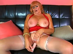 Naughty, big-titted, 61-year-old divorcee...got your attention? : Heres Jackie, a 61-year-old whos married and splits her time between Oregon and California. Shes a naughty woman.br br Im here to show you a good time, she says at the start of this video. I cant wait to show you everything Ive got.br br Jackie keeps up the jack and fuck talk throughout this video as she proudly shows off and licks her FF-cup tits and then spreads and toys her well-traveled cunt. And did we mention that shes a redhead? Well, she is, although you couldnt tell by looking at her pussy, which is shaved, of course.br br We asked Jackie how a man can get her attention, and she said, By staring at my big boobs. Then when I catch him staring at my boobs, he needs to be charming and funny and blush a little bit because I caught him staring. Of course, then Ill stare at the bulge in his pants, and thatll embarrass him even more. But if I like him, its only a matter of time before those pants are coming right off! And I dont care where we are!br br Well, were at 40SomethingMag.com. And Jackie is ready for you.