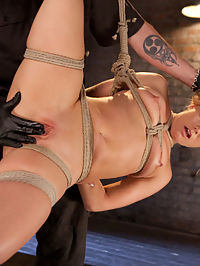 AJ Applegate Submits To Grueling Bondage and Torment!!! : AJ doesnt do many bondage shoots any more, so when we found out that she wanted to come back to Hogtied, we jumped at the chance to shoot her. She is quickly tied up in a standingsquatting stress position. Her clothes are ripped away and the torment begins. Next she is face down with her legs spread wide on our Y table. After the magnificent ass is spanked it is filled with a massive dildo. Her pussy is next so that we can double penetrate her. We finish her off with an pussy hook tied to her hair.She is suspended in a side suspension with one leg up to give access to her honey hole.The Pope takes turns fucking her throat and pussy until she is exhausted from orgasms.The day is finished with a hogtie that slowly becomes more and more grueling as the scene goes on. Once she cant take any more her pussy is fucked into explosive orgasms.