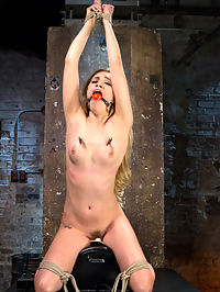 Young Blonde Babe is Devastated in Brutal Bondage and Made to Cum : Lyra is fairly new to showing her submission. She usually is the one dishing out the torment, but today she wants to see what its like taking it. We warm her up as not to blow her out in the first scene. Shes reluctant to go too far too fast, but she is willing to try, and thats all I need to hear. We keep going and little by little we get to see her let her gaurd down, which allows us to see her suffer through grueling bondage, her first suspension ever, torment, and screaming orgasms.