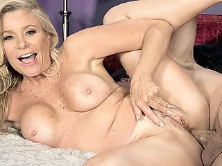 Lauren gags and gets ass-fucked : Lauren Taylor, a 56-year-old mother and divorcee from Southern California, gags on a big cock and takes it up the ass in her first video at 50PlusMILFs.com. As debuts come, this one is very hot. Heck, it would be hot even for an experienced porn star. Most porn stars do not make themselves gag on dick. Most porn stars do not take it up the ass. But, as Lauren tells us in the interview that precedes the fucking, If Im on the menu, its on the menu.br br And how does a guy know its anal time?br br I say, Fuck me in the ass, Lauren said.br br Not everybody gets her ass but some guys get it the first time. She likes to be ass-fucked while spooning. Spooning is usually a very cuddly position, but why cant a woman get ass-fucked while shes being cuddly? No reason we can think of. Romantic ass-fucking. We like the idea of that.br br Lauren is exactly the kind of woman we think of when we hear the phrase, hot MILF. Shes blonde. Shes busty. She has a great body. Not surprisingly, her sons friends used to hit on her, but she never fucked them. That wouldnt have been right.br br Getting ass-fucked by strangers on-camera is definitely right.br