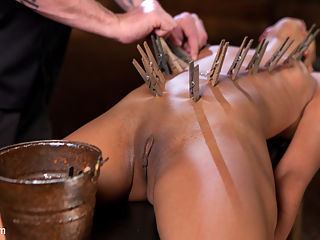 Skin Diamond is Tormented in Brutal Bondage and Made to Cum!!! : We begin in a simple yet effective hands over the head standing tie. Her clothes are ripped away exposing her sexy body to be tormented. The bondage is manipulated in a way to contort her body and put her in predicament bondage. A crotch rope is added to finish the tie and make Skin completely helpless.Skin is on her back for the next scene with her body in a very vulnerable position. Clothespins are applied to all of the sensitive spots on her body and then flogged off as she is made to cum uncontrollably. Next we have Skin in a hogtie suspension. Nipple clamps are added and then pulled on to make this slut scream. Her feet are tormented and then we fuck her pussy until she begs for it to stop.In the final scene Skin has all of her body weight resting on her pussy that is perched atop a sybian. She is tormented as orgasm after orgasm pour out of her pussy until The Pope has to physically hold her place because she is thrashing around so hard from cumming so much!