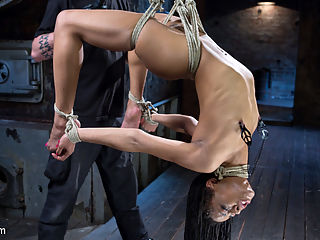 All Natural Ebony Newcomer in Brutal Bondage and Suffering Like a Pro! : Kira is new to Hogtied, but is very in tune with what she wants, and is willing to learn things she still doesnt know. My goal for the day is to make sure this sexy little bitch gets everything that she can handle and then push her a little further just to see what happens. The day starts with her bent over and getting ass fucked, and we maintain that pace for the rest of the day. The bondage is grueling and the torment is harsh. She handles it all like a fucking pro, and you will definitely see her again soon.