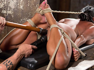 Big Tits Bound, Tormented Body, and Pussy and Face Fucked : Maxine is new to Hogtied and is anxious to get started. We begin with her pussy getting tormented on our wooden pony. The predicament keeps constant strain on her body as she fights to keep from hurting herself anymore. She is flogged and toyed with before she is allowed her first orgasm.Next we put her in a hogtie and introduce her to more torment. Her head is tied back to her feet allowing full access to her fuck hole of a mouth. Her throat gets plunged fast and hard with a dildo and then her pussy gets the same treatment.In the final scene we have her completely helpless in a spread eagle on the floor. She is assaulted even more and then squirting orgasms are ripped from her body until she cant squirt any more.