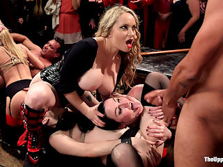 100 Orgasm Slave Girl Orgy : The epic conclusion of Stefanos Birthday party, in which he demands the horny crowd of BDSM swingers and beautiful anal slave whores to deliver him 45 orgasms - He will now live forever, because this wild night provided him 55 years to grow on. Perfect slave girl Veruca James hangs helplessly in brutal suspension while being fucked from behind, her mouth stuffed with cock while her newbie trainee eagerly laps at her ass. Both girls deliver many tormented orgasms in bondage, screaming for mercy and delighting the crowd. Cute as a button, and quiet as a mouse, slave Sydney Cole must learn to scream and entertain as her pussy pleasured and punished. Her anal slave charge, Nora Riley Has her tight pink asshole stuffed with hard cock and must hold her orgasms and endure electro torment until her senior slave can learn how to cum like a good slut, loudly and eagerly. The final conclusion is a complete fuck fest with plenty of anal, cruel lesbian sex, facials, single tailing, and a final 45 clamp zipper that leave our slaves breathless and cumming in a pile in front of our appreciative guests. Dont miss the bonus crowd action with plenty of dirty play and rope suspension!
