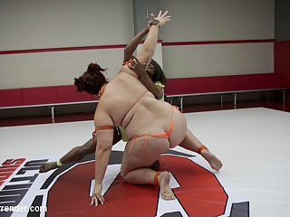 Two Big Bad rookies made it to Summer Vengeance : Kelli Provocateur and Mimosa were too big and strong to be in the rookie cup tournament so we put them straight through to summer Vengeance. This match proves why these girls were too much for the rookie cup tournament to handle with brutal wrestling holds and submissions. Winner Throat fucks the loser, makes the loser worship her muscles and lick her armpits. Loser is hand gagged and made to suck on the winners huge click