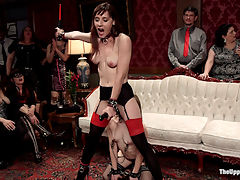 Slave Girls Debased and Anally Ravaged at Private BDSM Party : Audrey Holiday is a lithe beauty, fully trained in the art of inspiring hard ons and working every drop of cum out with her perfect ass. Queue the newbie, Alice Marsh, an all natural babe with a willingness to serve and an innocent submissive nature that drives our party of BDSM players wild. Audrey must train her new slave meat how to entertain a salacious crowd of horny men and women using her tight body and dick hungry holes. A beautiful display of good slave training, these women take tight nipple clamps, crops on their pink pussies, and cum while being flogged, ruthlessly fucked, humiliated and made to lick each others asses for the guests pleasure. How many loads of hot cum can they get on their faces? Watch to find out.