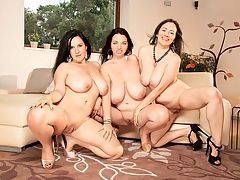 Girls Who Love Girls : When Joana, the Countess of Cleavage, and her girls Roxanne Diamond and Amorina got together for a Big Tit Pussy Picnic, they were in a quiet park where there was a strong chance of accidental exposure or someone spying on their sexing.br br This time, the three amigas decide to hold an indoor slumber party love-in minus the slumber and minus the nightgowns. This time, the girls are all dressed up in party dresses and heels.br br They waste no time with small chit-chat. Amorina kneels on the floor before Joana and pulls her top down. Roxanne cops a feel of Amorinas ass, then goes for a lip-lock with Joana. The dominant Joana takes Amorina and Roxanne by their hair and brings their faces together so they can kiss and swap tongue twirls. Joana watches their mouth-play with erotic pleasure.br br Instinctively, both girls pull off Joanas bra and each babe takes one of Joanas big tits between her hands. This emphasizes the sheer size of Joanas huge boobs. Their hands are tiny compared to Joanas hooters. Roxanne and Amorina each kiss and suck a nipple as Joana moans with excitement. She is their breast goddess they are her pleasure servants.br br Joana lies back on the couch, legs open. Roxanne hugs and kisses her while Amorina feels Joanas pussy through her panties, then pulls the panties to the side to examine her smooth, thick-lipped box thats ready to get juicy. Their three-way tits and slits worshiping has only just begun.