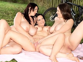 Joana, Roxanne and Amorinas Busty Picnic : Its a picnic in the park for giggling and happy bicycling babes Roxanne Diamond, Amorina and their magnificent role model, the great Joana, goddess of big boobs. They lay down a blanket, but box lunch is not on the menu. The three girls are the box lunch.br br Joana and Amorina tease Roxanne, the girl on her back. Their soft hands begin to peel off Roxannes clothing, revealing her erect nipples. Shes turned on and wants to turn on her girlfriends, tit for tat.br br Amorina and Roxanne kiss while Joana supervises. Joana gets topless and Amorina strips down to her pants. Amorina climbs on top of Roxanne and dry humps her.br br All three girls kneel, Roxanne in the middle. Amorina and Joana kiss and play with Roxannes nipples, They strip down Roxanne. She climbs on top of Amorina and grinds her while Joana grinds Roxanne from behind.br br Amorina and Roxanne double-team Joana. All panties get tossed away. Joana lies back so Roxanne can get on top of her and hump her. As their girl orgy of lust continues, fingers fuck cunts and tongues mash. Having big tits is no picnic? Yes, it is!