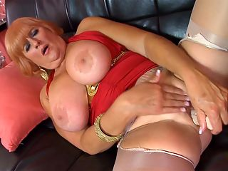 Naughty, big-titted, 61-year-old divorcee. Got your attention? : Heres Jackie, a 61-year-old whos married and splits her time between Oregon and California. Shes a naughty mom.br br Im here to show you a good time, she says at the start of this video. I cant wait to show you everything Ive got.br br Jackie keeps up the jack and fuck talk throughout as she proudly shows off and licks her FF-cup tits and then spreads and toys her well-traveled cunt. And did we mention that shes a redhead? Well, she is, although you couldnt tell by looking at her pussy, which is shaved, of course.br br We asked Jackie how a man can get her attention, and she said, By staring at my big boobs. Then when I catch him staring at my boobs, he needs to be charming and funny and blush a little bit because I caught him staring. Of course, then Ill stare at the bulge in his pants, and thatll embarrass him even more. But if I like him, its only a matter of time before those pants are coming right off! And I dont care where we are!br br Well, were at YourMomsGotBigTits.com. And Jackie is ready for you.