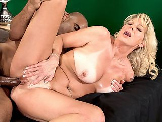 Nikkis first BBC : Ive been wanting to fuck a black man for so long, 50-year-old divorceemom Nikki tells Asante at the start of this scene. Shes dressed to fuck in a tiny yellow dress, and before long, Asante is examining her ass and Nikki is naked and showing off her tan lines, which are about the most extreme tan lines weve ever seen.br br Then Nikki gets on her knees and sucks her first black cock then she gets on all fours to suck cock while her tits wobble and Asante spreads her ass then Asante slides his cock into Nikkis gaping cunt as she goes for a ride. Nikkis pussy is a real gaper, but Asante fills it up, and Nikki clearly loves her first black cock.br br Of course, the cum that glazes her face and tongue is white. Because, lets face it, in this great, big world of ours, arent we all brothers-in-cum who just want to fuck horny MILFs?br br By the way, it took Nikki 50 years to get her first black cock. Was it worth the wait?br br Definitely, she said. But Im not going to wait for my next one. br