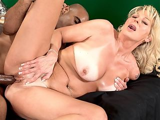 Nikkis first BBC : Ive been wanting to fuck a black man for so long, 50-year-old divorceemom Nikki tells Asante at the start of this scene. Shes dressed to fuck in a tiny yellow dress, and before long, Asante is examining her ass and Nikki is naked and showing off her tan lines, which are about the most extreme tan lines weve ever seen, so fascinating that we almost forgot that we were looking at naked tits.br br Thats almost forgot.br br Then Nikki gets on her knees and sucks her first black cock, then she gets on all fours to suck cock while her tits wobble and Asante spreads her ass, then Asante slides his cock into Nikkis gaping cunt as she goes for a ride. Nikkis pussy is a real gaper, but Asante fills it up, and Nikki clearly loves her first black cock.br br Of course, the cum that glazes her face and tongue is white. Because, lets face it, in this great, big world of ours arent we all brothers-in-cum who just want to fuck horny MILFs?br br By the way, it took Nikki 50 years to get her first black cock. Was it worth the wait?br br Definitely, she said. But Im not going to wait for my next one. br