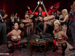 A Slave Orgy Like No Other : Senior slaves Bella Rossi and Mona Wales show the ropes to two incredibly eager newcomers in a competition orgy of epic proportions! James Mogul and Aiden Starr have their hands full teaching two cock hungry newbies how to fuck, suck and serve in a roomful of lifestyle players and kinky swingers. Lilith Luxe and Kira Noir are pushed to their limits, enduring an endless stream of pussy and ass torment, all while being teased with the coveted red and black collars reserved for deserving senior slaves. In this, the first of two installments, Lilith Luxe explodes with orgasms while being fisted by Aiden and covered with a string of clothes pins that the house guests ultimately rip from her as she screams in ecstasy. This delicious, greedy trainee is then zapped, caned and fucked, while Mona Wales helps her through her ordeal, taking on a serious ass pummeling for herself by Mickey Mods enormous cock. Will Lilith learn to control her endless orgasming and earn her collar? Can Mona keep this trainee slut in line? Stay tuned for part two, coming soon.