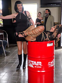Fugitive Biker Bar Gets Serviced! - Part 2 : Melody Petite is a perky slut in a box - Part 1Mistress Minerva has a present for Steve! Its Melody Petite, a perky little slut all wrapped up in a box! This barefoot whore sluts her tight ass all over the city for everyone to get a taste! Mistress Minerva loves playing with her toy and delivers some corporal punishment for the city to see. Melody is soo hot from this Steve even has to dunk her in the public fountain to cool down. Fugitive Biker Bar Gets Serviced! - Part 2Tied up in rope bondage, Melody Petites smiling pussy becomes a perfect tourist destination! Everyone at this rowdy bar wants to get a picture with her. After a round of flogging, Mistress Minerva brings out the electric zapper and makes Melody scream with orgasmic pleasure! Melody is still so hot, Minerva has to spit cold water on her face and pussy. After Melodys high heels come off, one lucky patron gets to fulfill all his foot worshipping pleasures and suck on her tiny toes. But dont let those feet get away yet, Melody is ticklish and gets tormented by Mistress Minerva! Finally a round of blowjobs for bikers and fucking by big dicks that are almost too big to fit in her tight pussy, Melody gets drenched in cum!