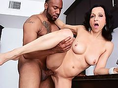 Karmas cookin in the kitchen : Karma Karson, a 46-year-old MILF from Las Vegas, pours Jovan his morning coffee and accidentally-on-purpose spills some milk onto his fingers and suit. She licks the milk off his fingers in a very blow job-type way, then she keeps licking his hand like shes a cat lapping up milk.br br Karmas looking very sexy in a short, red strapless dress and heels, so it doesnt take much to convince Jovan that he should be late to work. She sucks his big, black cock then they fuck right there in the kitchen, on the counters and the floor, before he blows his load in her mouth. Well, not entirely in her mouth. Some of it drips down her forehead and into her eyes and off her nose and into her mouth. Shes a complete cum mess by the time this scene is over.br br Karma is a webcam model who describes herself as a lady in the street, a freak in the cam room. She can add freak at 40SomethingMag.com to that, being that most women do not suck and fuck honest-to-goodness cock on-camera. She says shes pretty open about her sexuality and says she doesnt have sexual fantasies. She lives them.br br Doing this was one of them. She made our fantasies come true, too.