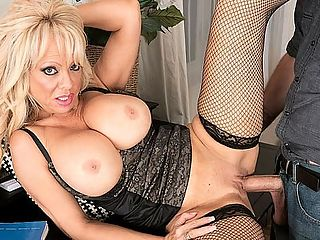Busty MILFs first time : I can dress conservative or sexy slutty, said Bella Dea, a busty 54-year-old MILF from Southern California.br br Here, Bellas attire is what we call business slutty. Its certainly not conservative, not with her tits popping out of her button-down blouse and those fishnet stockings she has on. But if she buttoned a few buttons, you might call her attire businesslike.br br In this scene, Bella goes about her business of sucking Jimmys cock and riding it hard. Jimmy goes about his business of dropping his load in her mouth. This is Bellas first video at 50PlusMILFs.com, and its a good one. Theres something slutty about her. We think she might look slutty even in conservative clothing, and we mean that as a compliment.br br Bella has DDD-cup tits and two daughters. We have no idea why we put those two facts in the same sentence. Shes worked in television and film. Shes been a makeup artist. Shes been a fetish model. Now, shes on her way to becoming a porn star.br br Shes had sex with younger men. I like to teach them new tricks, she said. She likes to be watched while having sex. Shes into women. Were into her. Jimmys definitely into her. Just watch.