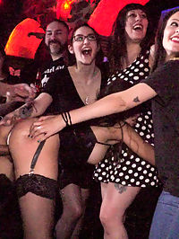 Underground Goth Club turns into a Wild Fuck Party! : Part 1 - Spanish Slut Fucked OutdoorsFrida Sante is a gorgeous Spanish slut who loves to take it hard for all to see. Fully outdoors in front of a crowd she gets fucked, spanked, and put to work on the cock! This gorgeous slut can really take it from all ends while strangers gasp at the hard face fucking happening right before their eyes! This scene ends up being soo hot for Frida in her tight black dress, stockings and latex garter that she needs to take a public dip in the local fountain!Part 2 - Underground Goth Club turns into a wild fuck party!Steve Holmes drags Frida Sante to a crowded underground goth club, where the patrons are ready and horny for all the action they can get! The sexy goth sluts at this club take turns flogging Fridas perfectly round ass before making her crawl on her hands and knees to sniff every hot piece of ass in the joint. Unable to control herself one of the smoking hot petite whores strips naked and goes in for some lesbian pussy licking and face sitting. As the night goes on the whole bar gets their tits out and joins in the wild party. Frida needs to be tied up in tight rope bondage to be fucked with an anal plug while the audience gets flogged before a huge cum shot cock sucking for everyone to enjoy.
