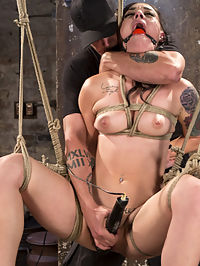Slut Begs for Extreme Bondage and Grueling Torment to Make Her Cum : Rachael is sexy as hell and as soon as he rope touches her flesh, you can tell that she is a real rope slut. She is the kind of girl that immediately responds to the pain and bondage with a welcoming grin that says, Hurt me more. Every scene gets a little more intense than the last one, and Rachael pussy gushes with squirting orgasms to prove that she loves to suffer at the hands of The Pope.