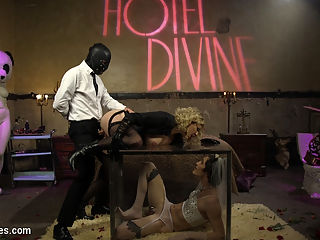 Honeymoon Cuckold At Hotel Divine : Maitresse Madeline Marlowe brings her new feminized bride to Hotel Divine for their honeymoon weekend. Tony is beautiful in full feminization and is treated like the virginal bride he is. He happily endures whipping from Madeline and her gimp bull, large toy insertions, big strap-on pegging and anal fisting so deep it pops his internal anal sphincter! Hes so turned on she makes him ride his HUGE toy for her and her gimp bulls amusement while he strokes his cock. This makes him blow his load all over their black leather shoes and is made to clean it up with his mouth. As if that wasnt enough she puts him in a clear plexiglass box while his wifey Madeline gets pounded hard with gimp bull cock. Tonys little clit stick is locked away in metal chastity. She does let him leave the box but only to suck the cum off her bulls cock and she strokes the gimps dick all over the blushing brides face! The is easily the BEST cuckolding movie of the year! Not to be missed!