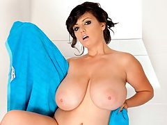 Rub-A-Dub-Dub, Big Tits In A Tub : What does Arianna do before going on a big date? Well, she soaps up her G-cup naturals and makes sure her pussy and ass are suckable and fuckable, thats what she does. Its bath time with Arianna, and, as we all know, big, natural tits look particularly nice when theyre wet, shiny and soapy.br br In this video, we get loads of hanging shots as Ariannas tits dangle above the water, and the camera dude was good enough to get down and give us some views looking up at her pussy and ass. Then Arianna pulls out a multi-colored dildo, but its not quite enough to satisfy her.br br Oh, my tight pussy needs a real cock right now, Arianna says.br br And guess what? Next week, she gets one, in photos and videos, only at BustyArianna.com.
