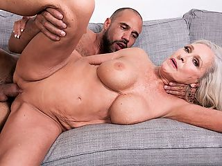 Katias happy return has a happy ending : In her first XXX video scene in seven years, Classy Katia, whos 63 now she was a 50Plus MILF the first time we saw her in 2011, takes on the cock that started it all for her in 2009. Its Carlos cock, and Katia obviously loves it. Or maybe its just obvious that she missed fucking on-camera and was eager to get back to it. Which she was.br br Katia is from Alabama. Shes a mother, grandmother and divorcee. She says the people who know her would be shocked to see her here, Hey, we were shocked to see her come back after such a long absence. But her return is a great way to finish off the year.br br Katia was born on August 3. Her measurements are 34C-25-36. She has blue eyes, and her hobbies including walking and riding horses. She has a foot fetish. Back in 2009, she told us that her sexual fantasy is being with four guys at one time. Well, seven years later, she still hasnt fulfilled that fantasy which, frankly, shocks us because shed have no time rounding up four eager guys to fuck her.br br We also asked her how often she has sex, and she said, About three times a month.br br Part of the reason for that is shes not a swinger. Another reason Shes been busy working and taking care of her family. Otherwise, we might have seen her here sooner.br br Anyway, enjoy Katias happy return and know that theres lots more of her to come. Hey, you didnt think we were going to just shoot one scene after we hadnt seen her for so long, did you?br